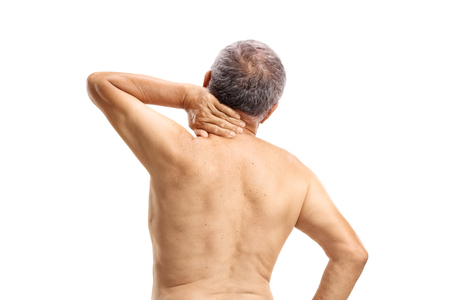 Shirtless mature man experiencing neck pain isolated on white background