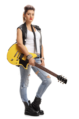 subculture: Full length portrait of a female punker holding an electric guitar isolated on white background