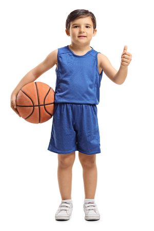 Full length portrait of a little basketball player making a thumb up gesture isolated on white background Stock Photo