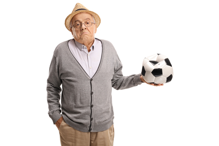 Disappointed mature man holding a deflated football isolated on white background