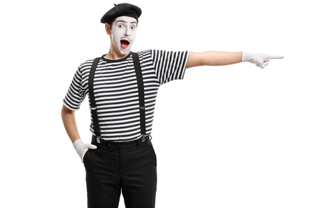 Mime artist pointing isolated on white background