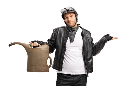 Disappointed biker holding an empty gas can isolated on white background