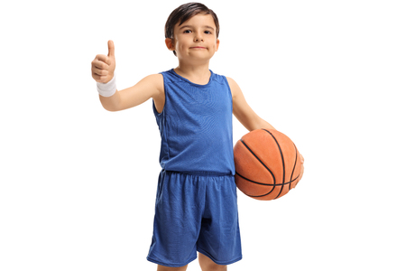Little basketball player making a thumb up gesture isolated on white background
