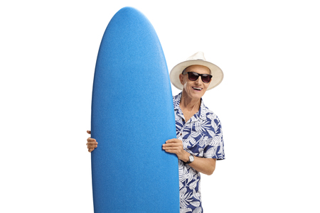 Elderly tourist holding a surfboard isolated on white background