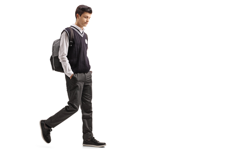 Full length profile shot of a pensive teen student walking isolated on white background