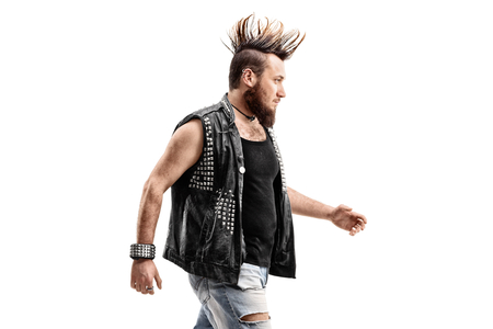 subculture: Angry punker walking isolated on white background