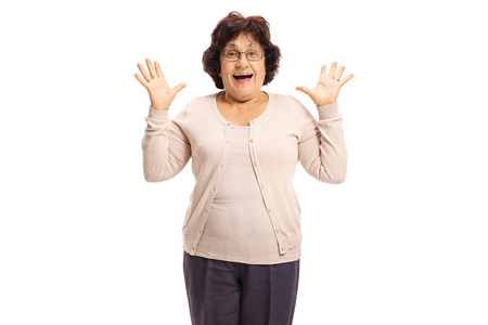 Surprised senior lady gesturing with her hands isolated on white background Stock Photo