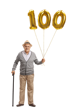 Full length portrait of a mature man holding a golden number hundred balloon and a cane isolated on white background
