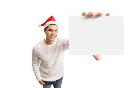 Young guy with a christmas hat showing a blank card isolated on white background