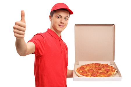 Teenage pizza delivery boy making a thumb up gesture isolated on white background