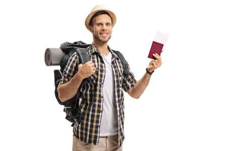 Tourist with a backpack and a passport isolated on white background Stock Photo