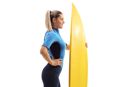 Female surfer with a surfboard isolated on white background