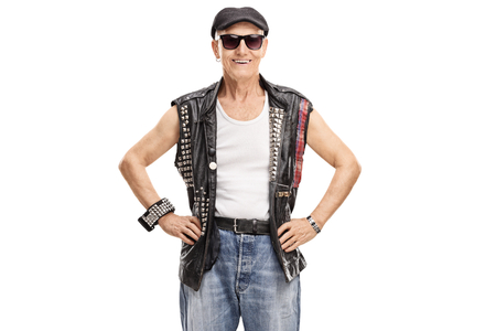 Old punker looking at the camera and smiling isolated on white background Stock Photo