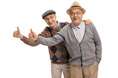 Seniors holding their thumbs up isolated on white background Stock Photo
