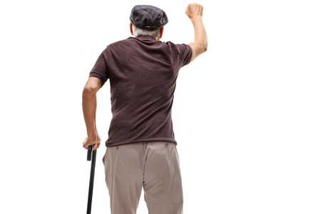 Senior knocking on a door isolated on white background