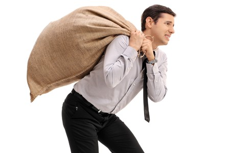 Businessman carrying a burlap sack on his back isolated on white background Stock fotó