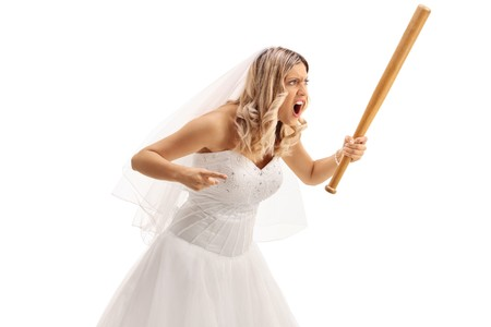 Angry bride with a baseball bat isolated on white background Stock Photo