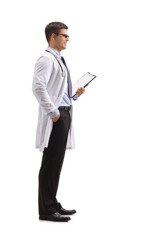 Full length profile shot of a doctor with a clipboard waiting in line isolated on white background Standard-Bild