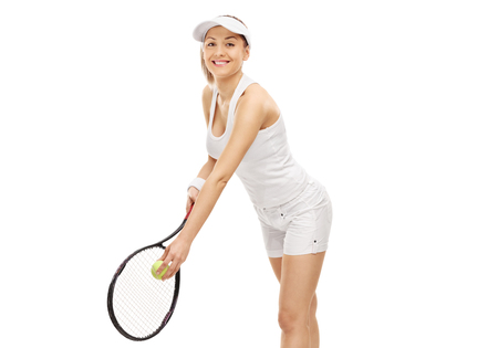 Female tennis player preparing to serve isolated on white background