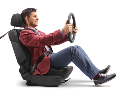 Elegantly dressed guy sitting in a car seat and driving isolated on white background Banco de Imagens