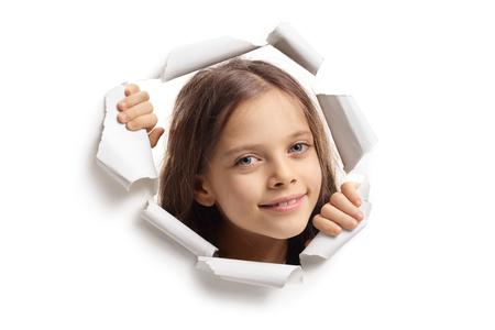 Little girl peeping through a paper hole