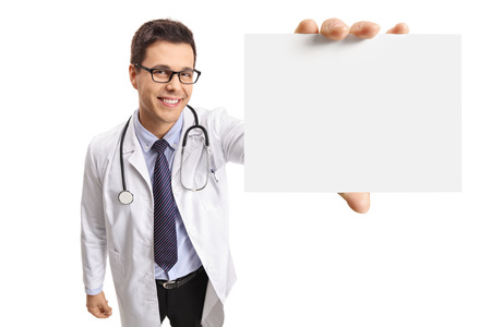 Young doctor showing a blank card isolated on white background