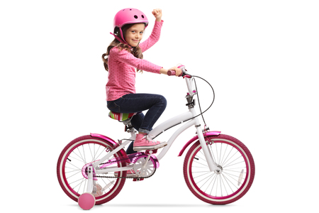 Little girl with a bicycle gesturing with her hand isolated on white background