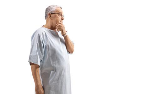Pensive elderly patient isolated on white background Foto de archivo