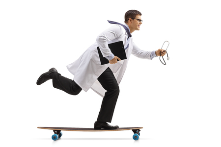 Full length profile shot of a doctor with a stethoscope and a clipboard riding a longboard isolated on white background Stock Photo
