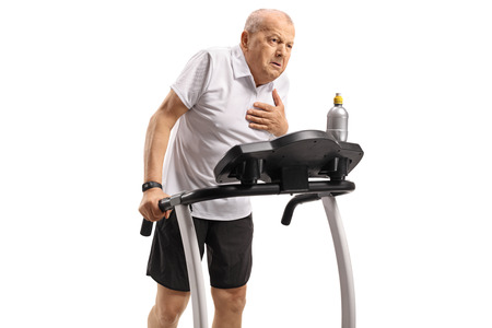 Senior exercising on a treadmill and having a heart attack isolated on white background