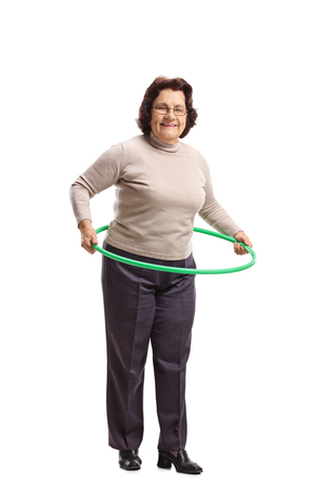 Full length portrait of an elderly woman with a hula-hoop isolated on white background Stock Photo