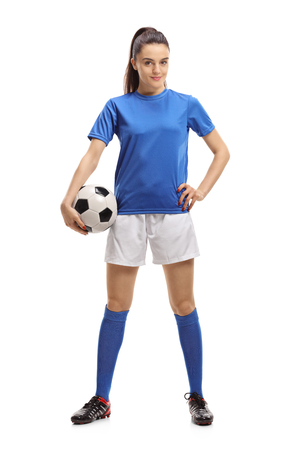 Full length portrait of a female soccer player with a football isolated on white background Stockfoto