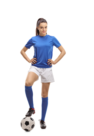 Full length portrait of a female soccer player isolated on white background Stockfoto