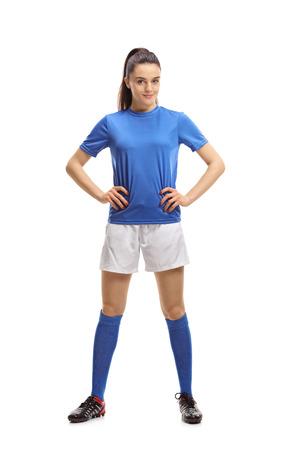 Full length portrait of a female soccer player isolated on white background 版權商用圖片