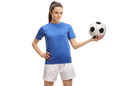 Female soccer player holding a football isolated on white background Stockfoto