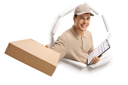 Delivery man with a package and a clipboard breaking through paper