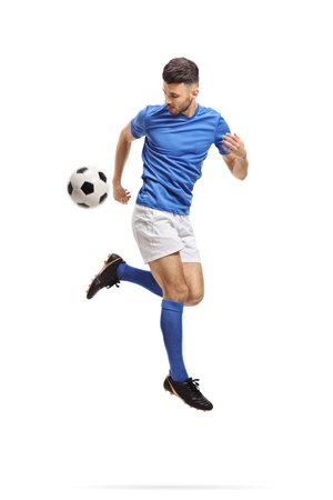 Soccer player performing a trick with a football in mid-air isolated on white background