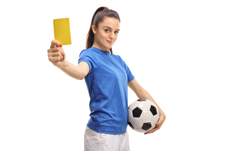 Female soccer player showing a yellow card isolated on white background Stockfoto - 98113010
