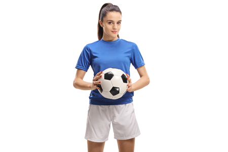Female soccer player holding a football isolated on white background Stockfoto - 98113108