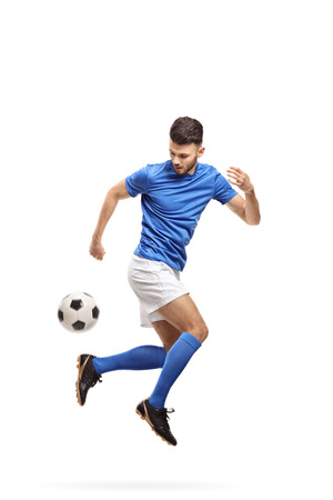 Soccer player doing a trick with a football isolated on white background