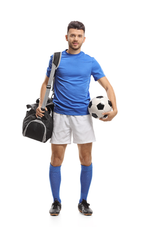Full length portrait of a soccer player with a sports bag and a football isolated on white background