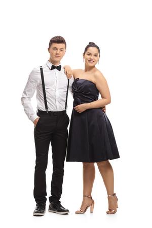 Full length portrait of elegantly dressed teenagers isolated on white background