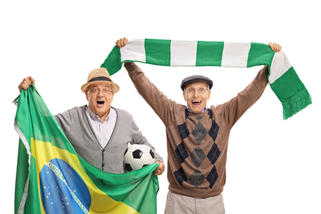 Cheerful elderly soccer fans with a Brazilian flag and a scarf isolated on white background Stock Photo
