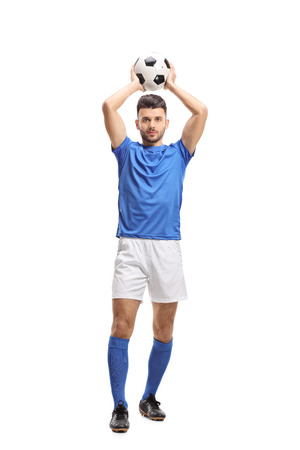 Full length portrait of a soccer player taking a throw-in isolated on white background