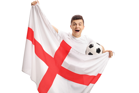 Overjoyed teenage soccer fan holding a football and an English flag isolated on white background Stockfoto