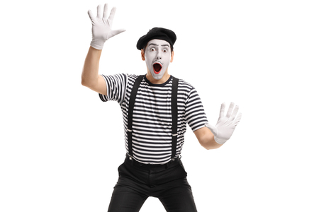 Mime holding his hands against an invisible wall isolated on white background Stock Photo - 102279999