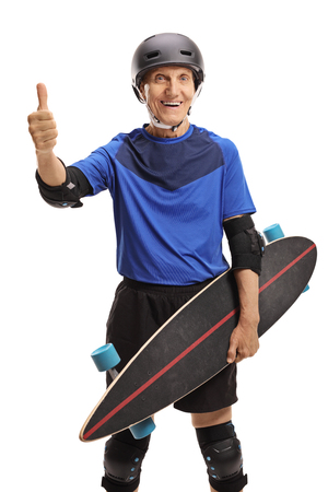 Senior with protective gear and longboard making a thumb up sign isolated on white background