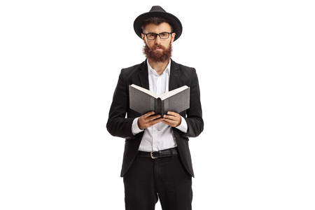 Religious man holding a book and looking at the camera isolated on white background Фото со стока
