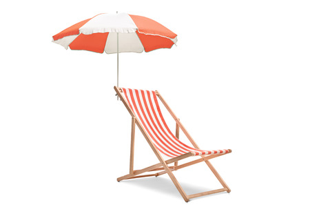 Deck chair with an umbrella isolated on white background