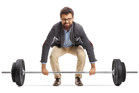 Young man struggling to lift a barbell isolated on white background